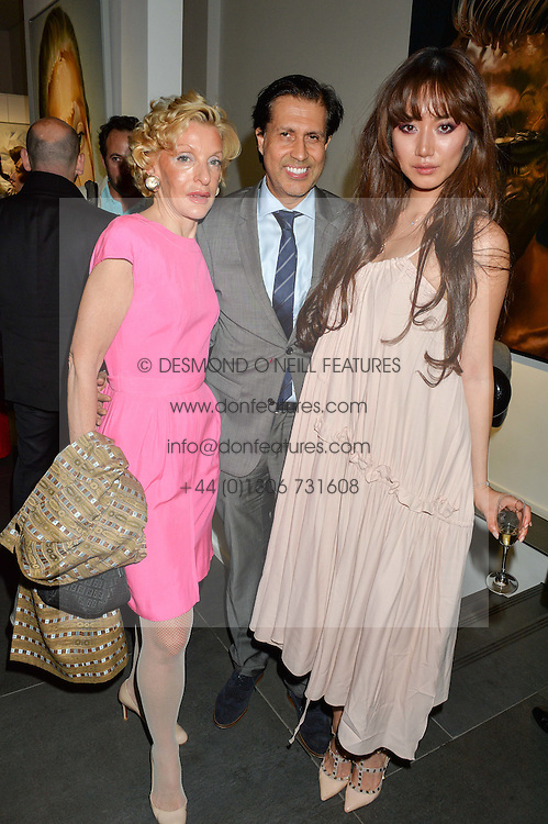Left to right, WENDY, COUNTESS CALEDON, ALEXANDER BARANI and BETTY BACHZ at a private view of woks by German artist Mike Dargas held at the Opera Gallery, 134 New Bond Street, London on 5th July 2016.
