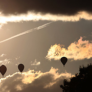 Hot Air balloons in the skies around rural Michigan near Battle Creek during the World Hot Air Ballooning Championships. Battle Creek, Michigan, USA. 20th August 2012. Photo Tim Clayton