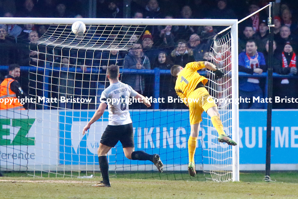 Leyton Orient's forward David Mooney chips the ball over Dover's keeper Mitch Walker to score a stoppage time winner for the O's during the The FA Trophy match between Dover Athletic and Leyton Orient at Crabble Stadium, Kent on 3 February 2018. Photo by Matt Bristow.