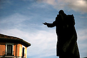 The silhouetted statue of the late Pope John Paul II in Madrid, Spain.
