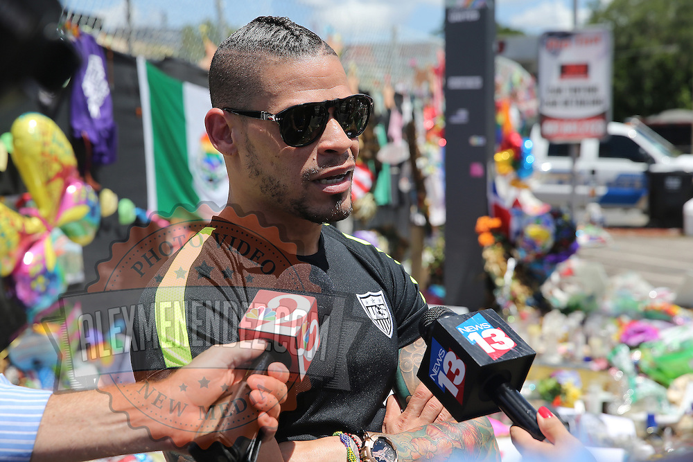 Olympian and professional boxer Orlando Cruz of Puerto Rico pays his respects to the victims of the Pulse Nightclub shooting on Tuesday, July 12, 2016 in Orlando, Florida. Cruz, who lost four friends in the tragic incident was the first openly gay boxer in the sport and will fight for his fifth time in the Orlando area this Friday.  (Alex Menendez via AP)