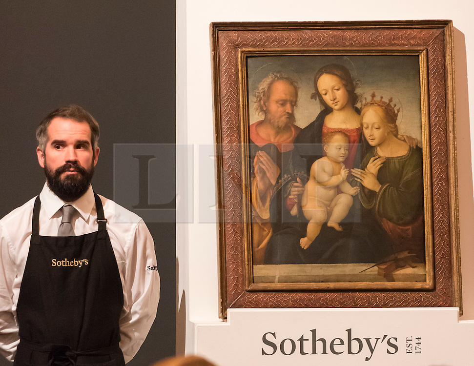 "© Licensed to London News Pictures. 07/12/2016. London, UK. ""The Mystic Marriage of Saint Catherine"" by Central Italian School which sold for a hammer price of GBP210k (est. 100-150k), at the Old Masters Evening Sale at Sotheby's in New Bond Street. Photo credit : Stephen Chung/LNP"