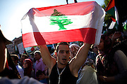 Mainz | 18 July 2014<br /> <br /> Am Samstag (18.07.2014) nahmen etwa 1000 M&auml;nner, Frauen und Kinder in der Innenstadt von Mainz anl&auml;sslich der milit&auml;rischen Auseinandersetzung zwischen Israel und der Hamas in Gaza an einer Solidarit&auml;tsdemonstration f&uuml;r Gaza, ein freies Pal&auml;stina und gegen Israel teil. Bei der Demo wurden Fahnen der Hamas und der Hisbollah mitgef&uuml;hrt, neben den &uuml;blichen Parolen gegen Israel wurde in Sprechch&ouml;hren auch vereinzelt zur Vernichtung von J&uuml;dinnen und Juden aufgerufen.<br /> Hier: Ein junger Mann h&auml;lt die Flagge des Libanon in die H&ouml;he.<br /> <br /> <br /> &copy;peter-juelich.com<br /> <br /> [No Model Release | No Property Release]