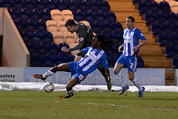 Colchester's Marcus Bean blocks a shot from Rotherham's Lee Frecklington - Photo mandatory by-line: Mitchell Gunn/JMP - Tel: Mobile: 07966 386802 04/03/2014 - SPORT - FOOTBALL - Colchester Community Stadium - Colchester - Colchester v Rotherham - Sky Bet League 1