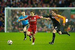 LIVERPOOL, ENGLAND - Wednesday, December 15, 2010: Liverpool's Joe Cole and FC Utrecht's Barry Maguire during the UEFA Europa League Group K match at Anfield. (Photo by: David Rawcliffe/Propaganda)