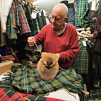 LONDON - JANUARY 23: A kiltmaker in London put the final touches to a musquash sporran to be collected for Burns night on Monday on January 23, 2010 in London, England. Scots across the world annually celebrate on January 25th the life of Robert Burns, the country's most famous bard, with recitations of his poetry, the eating of haggis and imbibing of whisky. (Photo by Marco Secchi/Getty Images)