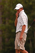 Mitch Pierce of Fenton reacts after his putt for birdie on the par 3, 6th hole of the Heather course at Boyne Highlands just misses during second round match play at the Michigan Amateur Golf Championship.