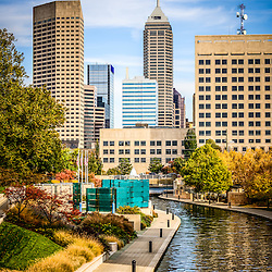 Indianapolis skyline picture in autumn with Canal Walk and downtown Indianapolis city buildings. The Indiana Central Canal was built in the 1800s and Canal Walk serves as a recreational attraction. Picture is high resolution and was taken in 2013.