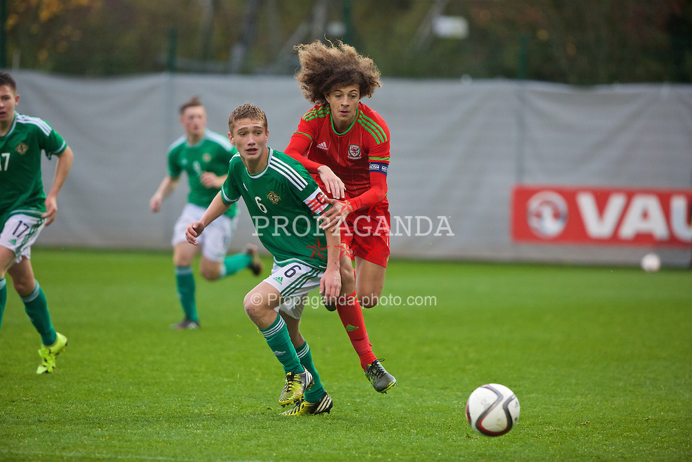 NEWPORT, WALES - Thursday, November 5, 2015: Wales' captain Ethan Ampadu in action against Northern Ireland's captain Luke Ferguson during the Under-16's Victory Shield International match at Dragon Park. (Pic by David Rawcliffe/Propaganda)