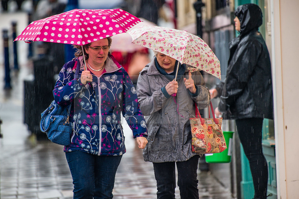 © London News Pictures. 06/02/2016. Aberystwyth, UK<br /> Strong winds and  cold driving rain make for uncomfortable conditions for pedestrians out shopping on Saturday morning in Aberystwyth Wales . Photo credit: Keith Morris/LNP