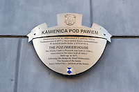 Sign showing Pod Pawiem Houseor House under the Peacock in stare Miasto or Old Town in Krakow Poland