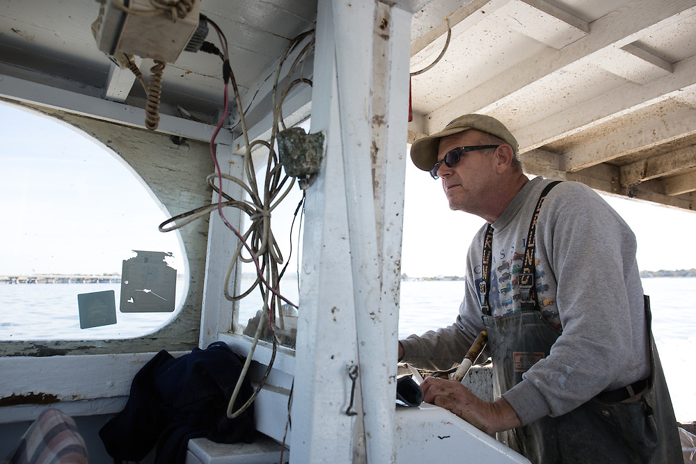 Captain Richard guides the boat to another set of his crab traps. | October 11, 2015