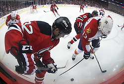 Feb 11; Newark, NJ, USA;Florida Panthers center Mike Santorelli (13) and New Jersey Devils defenseman Matt Taormina (32) battle for the loose puck during the first period at the Prudential Center.