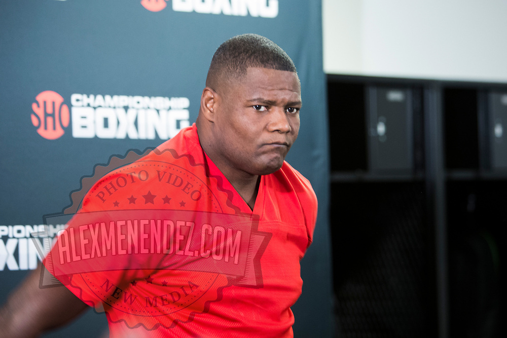 Luis Ortiz stretches in his locker room prior to his WBC Heavyweight Championship boxing match against Deontay Wilder at Barclays Center on Saturday, March 3, 2018 in Brooklyn, New York. (Alex Menendez via AP)