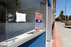 A broken window at an empty storefront along Georgia Street in downtown Vallejo, California.The city of Vallejo, California filed for bankruptcy protection in 2008 in attempt to deal with a ballooning budget deficit caused by soaring employee costs and declining tax revenue.