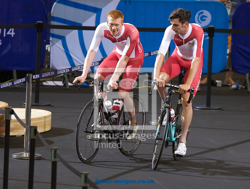 Steven Burke (L) and Andy Tennant cooling down after the  Men's 4000m Team Pursuit qualifying during day one of the track cycling at the Sir Chris Hoy Velodrome, during the Glasgow 2014 Commonwealth Games<br /> Picture by Alan Stanford/Focus Images Ltd +44 7915 056117<br /> 24/07/2014