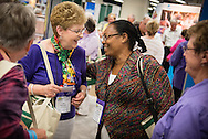 Lois Pohlmann and Tadelech Loha Shumbio greet each other in the exhibit hall of the 36th Biennial Convention of the Lutheran Women's Missionary League on Friday, June 26, 2015, at the Iowa Events Center in Des Moines, Iowa. LCMS Communications/Erik M. Lunsford