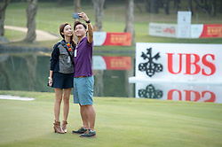 December 10, 2016 - Hong Kong, Hong Kong SAR, China - After play security fail to notice a couple sneak onto the 18th green to take selfies.Day 3 of the Hong Kong Open Golf at the Hong Kong Golf Club Fanling..© Jayne Russell. (Credit Image: © Jayne Russell via ZUMA Wire)