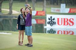December 10, 2016 - Hong Kong, Hong Kong SAR, China - After play security fail to notice a couple sneak onto the 18th green to take selfies.Day 3 of the Hong Kong Open Golf at the Hong Kong Golf Club Fanling..© Jayne Russell. (Credit Image: © Jayne Russell via ZUMA Wire)