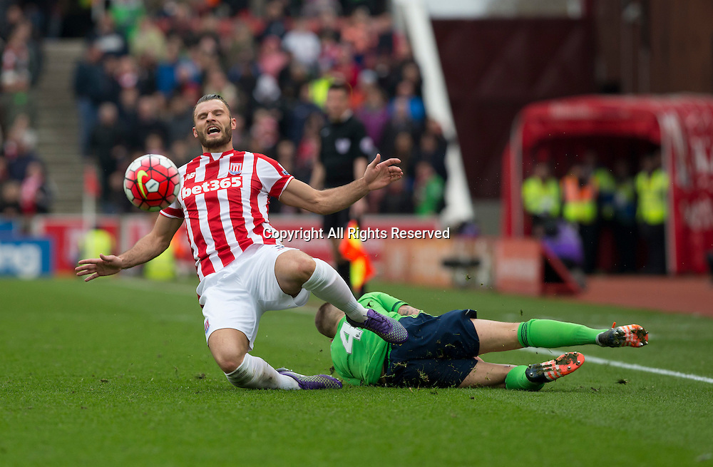 12.03.2016. Britannia Stadium, Stoke, England. Barclays Premier League. Stoke City versus Southampton. Southampton midfielder Jordy Clasie fouls Stoke City defender Erik Pieters leading him to receive a yellow card.