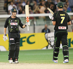 © Licensed to London News Pictures. 26/12/2013. George Bailey raises his bat after making his 50 during the 2nd T20 international between Australia Vs England at the Melbourne Cricket Ground, Victoria, Australia. Photo credit : Asanka Brendon Ratnayake/LNP