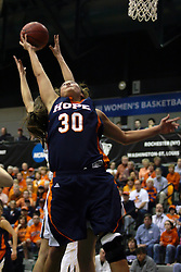 19 March 2010:Carrie Snikkers reaches for a rebound. The Flying Dutch of Hope College defeat the Yellowjackets of the University of Rochester in the semi-final round of the Division 3 Women's Basketball Championship by a score of 86-75 at the Shirk Center at Illinois Wesleyan in Bloomington Illinois.