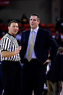 26 November 2005: ORU head coach, Scott Sutton laughs it up with a ref in the Oral Roberts University 62-54 victory over Monmouth University in the Great Alaska Shootout in Anchorage, Alaska..