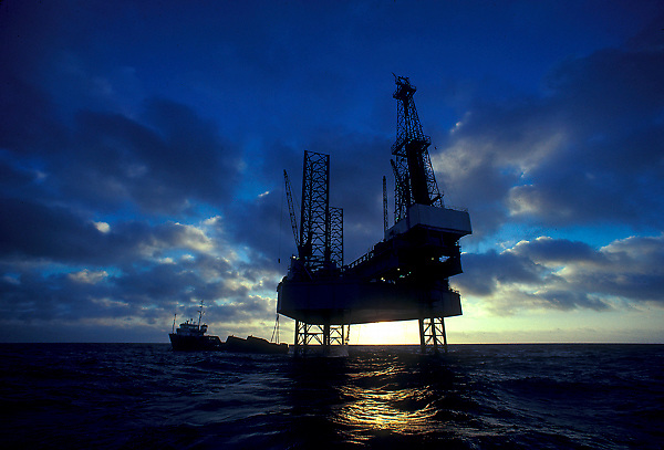 Stock photo of a jack up drilling rig off of the Gulf Of Mexico