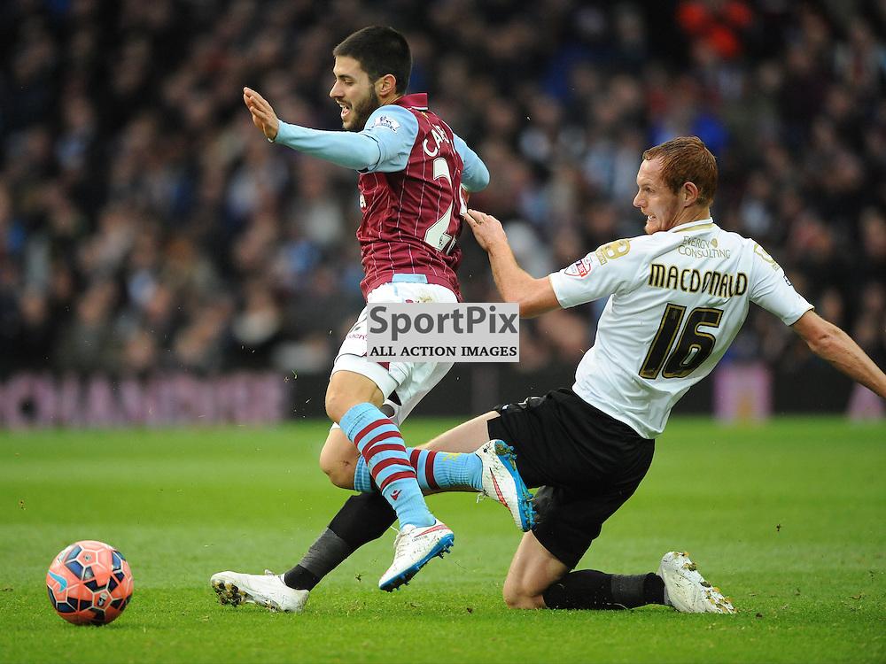 Bournemouth Shauan MCdONALD sLIDES IN ON vILLAS Carles GHil, Aston Villa v Bournemouth, FA Cup 4th Round, Villa Park, Sunday 25th January 2015
