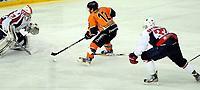 Ishockey<br /> 20.12.2012<br /> Eliteserien<br /> Frisk Asker v Lørenskog<br /> Foto: Ole Walter Sundlo/Digitalsport<br /> <br /> Erik Boisvert (12) - Frisk<br /> Nicolai Brynhildsen (33) - Lørenskog<br /> Jørgen Penker (29) - Lørenskog