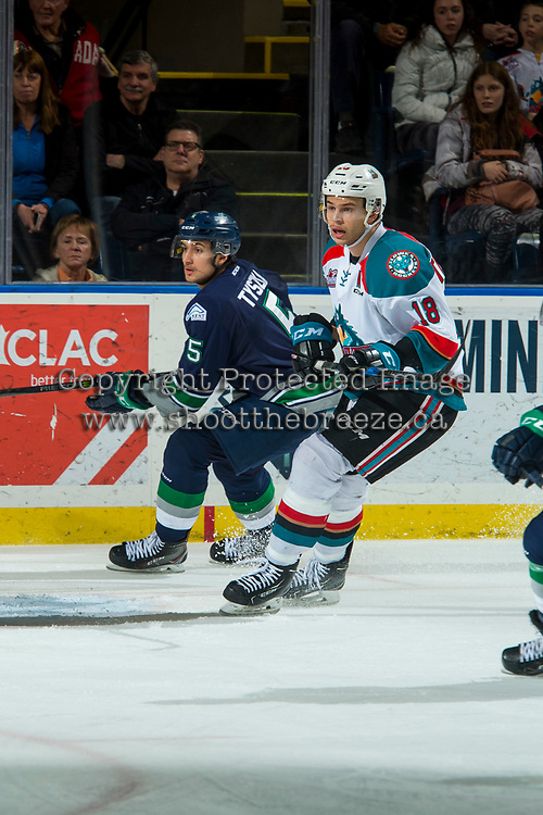 KELOWNA, CANADA - JANUARY 5: Jarret Tyszka #5 of the Seattle Thunderbirds and Carsen Twarynski #18 of the Kelowna Rockets skate on the ice on January 5, 2017 at Prospera Place in Kelowna, British Columbia, Canada.  (Photo by Marissa Baecker/Shoot the Breeze)  *** Local Caption ***