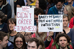 "© Licensed to London News Pictures. 31/08/2019. Manchester, UK. Placards reading "" We didn't order Eton Mess "" and ""Boaty McBoatface got more votes than you "" . Thousands attend a pro EU demo in Manchester City Centre and march en masse along John Dalton Street to join an Extinction Rebellion occupation of Deansgate . Objections are being raised about the Prime Minister Boris Johnson's intention to prorogue Parliament in the run up to Britain's planned Brexit deadline . Photo credit: Joel Goodman/LNP"