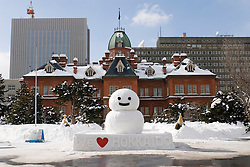Snowman outside prefecture Government offices in Sapporo during annual snow sculpture festival on Hokkaido Island japan