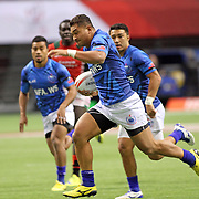 Samoa's Alamanda Motuga shows pace as he powers through Kenya, as Manu Samoa beat Kenya 26-19.  Canada 7's day one, second games, Vancouver, British Columbia.   Photo by Barry Markowitz, 4/12/16, 1:50pm