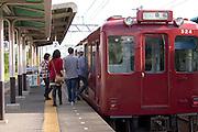 Tourists board the Yoro Tetsudo train for Kuwana Station as they leave the Tado Horse Festival.