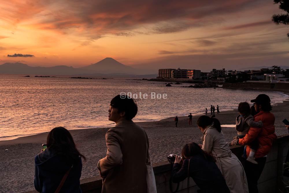 people watching the sunset with mounth Fuji near Kamkura Hayama Japan