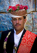 Yemen, Thula, groom with traditional turban decorated with flowers at his wedding.