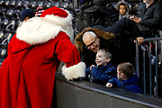 Young Fulham fans get there first sight of santa clause before christmas day during the EFL Sky Bet Championship match between Fulham and Barnsley at Craven Cottage, London, England on 23 December 2017. Photo by Andy Walter.