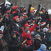 New Canaan supporters in action during the New Canaan Rams Vs Darien Blue Wave, CIAC Football Championship Class L Final at Boyle Stadium, Stamford. The New Canaan Rams won the match in snowy conditions 44-12. Stamford,  Connecticut, USA. 14th December 2013. Photo Tim Clayton