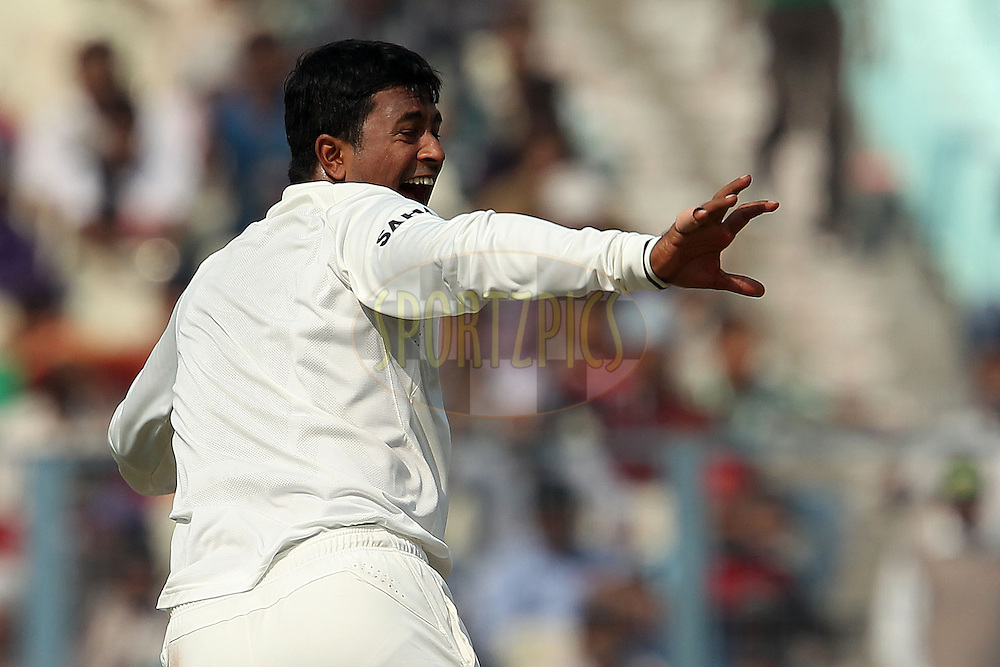Pragyan Ojha of India appeals for the wicket of Jonathan Trott of England during day three of the 3rd Airtel Test Match between India and England held at Eden Gardens in Kolkata on the 7th December 2012..Photo by Ron Gaunt/BCCI/SPORTZPICS ..Use of this image is subject to the terms and conditions as outlined by the BCCI. These terms can be found by following this link:..http://www.sportzpics.co.za/image/I0000SoRagM2cIEc