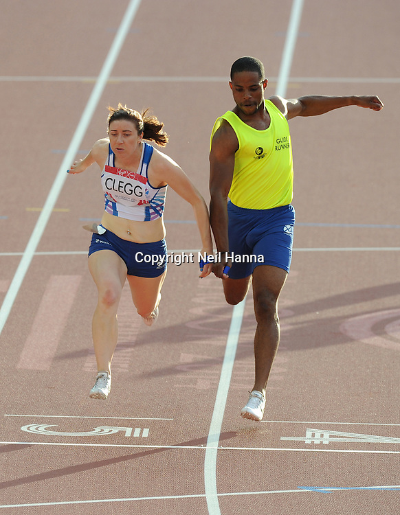 Commonwealth Games, Glasgow 2014<br />  Athletics, Hampden Park<br /> Women's Para Sport 100mm T11/T12<br /> Scotland's Libby Clegg wins the Gold Medal<br /> <br /> <br />  Neil Hanna Photography<br /> www.neilhannaphotography.co.uk<br /> 07702 246823