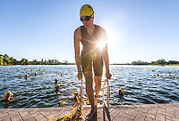 Omaha, Nebraska --<br /> <br /> Mariane Walin of Brooklyn Park, Minnesota, exits the warmup area before competing in the 1,500-meter swim of the Olympic-Distance National Championships triathlon at Carter Lake on Saturday, Aug. 13, 2016, in Omaha.<br /> <br /> MATT DIXON/THE WORLD-HERALD