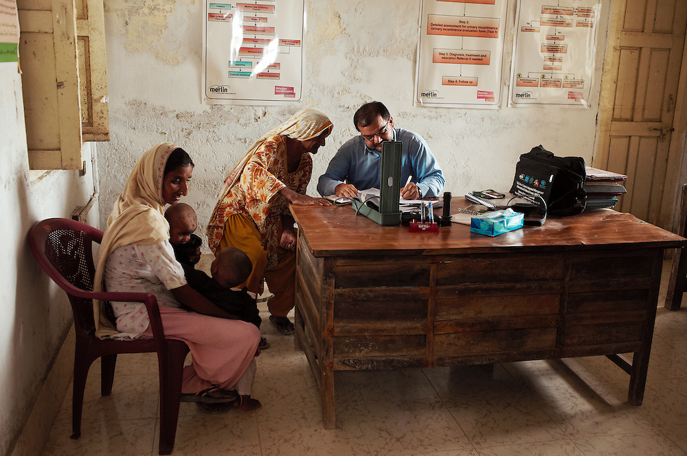 Patients seeks treatment from Doctor Isazeer Bughio at the Mitho Barbar government health clinic in Dadu, Sindh, Pakistan on July 4, 2011.