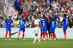 England's Raheem Sterling is dejected after France score thier first goal during the International Friendly at the Stade de France, Paris.