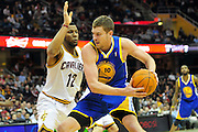 March 8, 2011; Cleveland, OH, USA; Golden State Warriors center David Lee (10) drives into Cleveland Cavaliers shooting guard Joey Graham (12) during the fourth quarter at Quicken Loans Arena. The Warriors beat the Cavaliers 95-85. Mandatory Credit: Jason Miller-US PRESSWIRE
