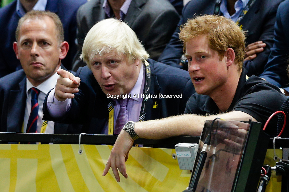 12.09.2014. London, England.  Invictus Games, day 2.  Wheelchair rugby.  Great Britain v Australia semi-final.  Mayor of London, Boris Johnson, watches on with Prince Harry