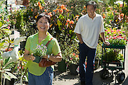 Mother and Adult Son at Plant Nursery