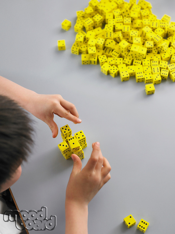 Schoolboy Playing with Dice