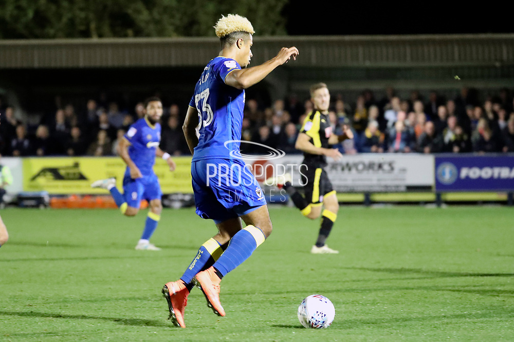 AFC Wimbledon striker Lyle Taylor (33) on his way to score during the EFL Sky Bet League 1 match between AFC Wimbledon and Rotherham United at the Cherry Red Records Stadium, Kingston, England on 17 October 2017. Photo by Matthew Redman.