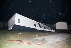 © Licensed to London News Pictures. 12/02/2014. Aberystwyth, UK A static caravan was overturned at Glan-Y-Mor Caravan Park near Aberystwyth today as winds reached 100MPH.. Photo credit : John Freeman/LNP